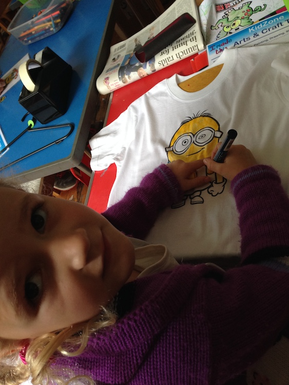 Aimee colouring her T-shirt